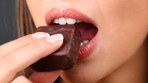 Woman_s_mouth_eating_chocolate
